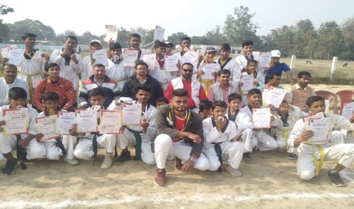 Medals and certificates distributed to district level champion ship winners